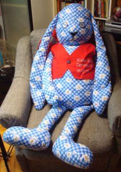 Заяц по эскизу в кресле